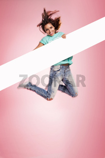 Woman jumping midair with a blank banner
