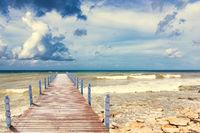 wooden pier extending into the sea