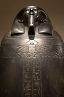 Egyptian sarchopagus with carved surface and hieroglyphic