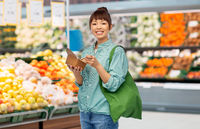asian woman with reusable bag for food and wok