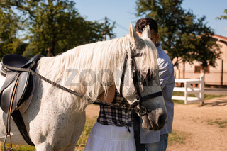 The couple in love spending time together on a ranch