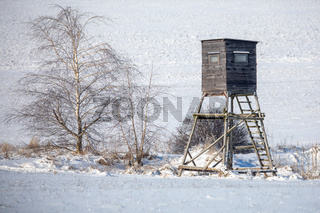 Winter hunting tower covered with snow