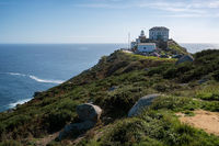 Cape finisterre landmark lighthouse with tourists on a sunny day in Galicia, Spain