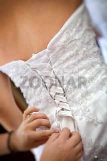Bride getting a wedding dress