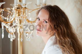 Beautiful woman against a chandelier