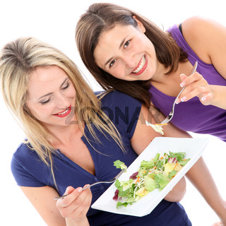 Female friends sharing a plate of salad