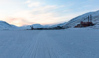 Pyramiden, Svalbard. Snowmobile tracks on the sea ice, leading to Pyramiden harbour.