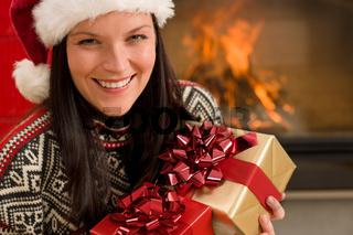 Christmas present woman Santa hat home fireplace