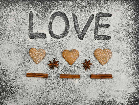 Heart shaped gingerbread cookies and love word