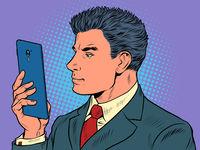 A man businessman looks at a smartphone Pop Art