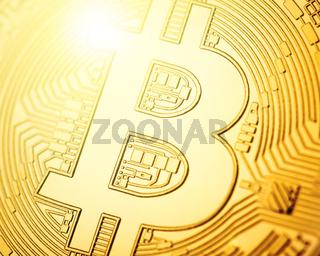 Macro shot of golden Bitcoin coin