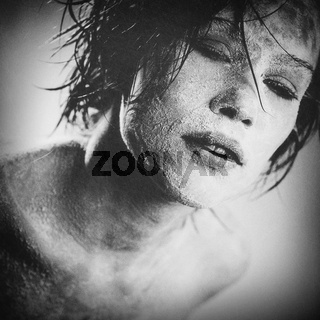 Zombie, grungy female portrait with added scratched texture