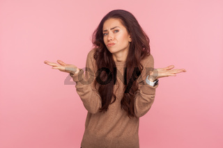 Portrait of emotional young woman on pink background.