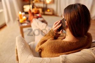 woman calling on smartphone at home on halloween