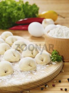 Meat dumplings on the kitchen board