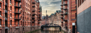 canal and historic buildings in old warehouse district Speicherstadt in Hamburg