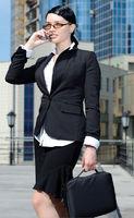 Beautiful businesswoman talking cellphone