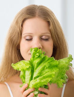 Young beautiful  woman with green lettuce