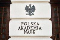 Warsaw, Poland, Nov 15, 2018: Coat of arms of Poland and plate of Polish Academy of Sciences on the Staszic Palace, the headquarters of the institution