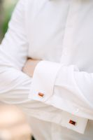 A man in a white shirt folded his arms across his chest