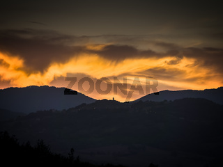 Tuscany with golden clouds