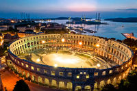 Arena Pula. Ancient ruins of Roman amphitheatre in Pula aerial evening view