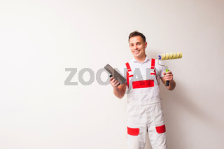 Cheerful handyman feeling himself on the right place