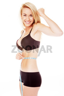 blonde woman measuring her stomache