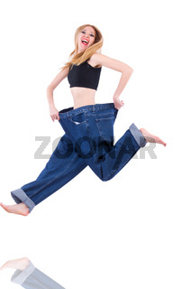 Woman in dieting concept with big jeans