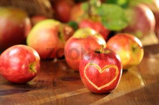 Apple heart on a wet table