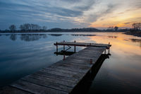 Wooden pier on a calm lake and evening clouds, Stankow, Poland