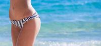 Slim and sporty girl over sea