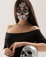 Glamorous Sugar skull girl posing at camera