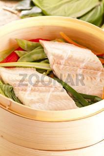 Fish fillet steamed with vegetables