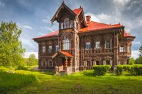 Restored wooden large house. A two story house made of wood. wood carving.
