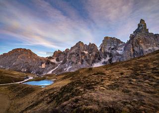 Evening twilight autumn alpine Dolomites mountain scene, Trento, Italy. Lake or Laghetto Baita Segantini view.