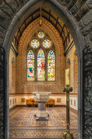 Interior, aspersorium or stoup and stained glass in St. Marys Cathedral