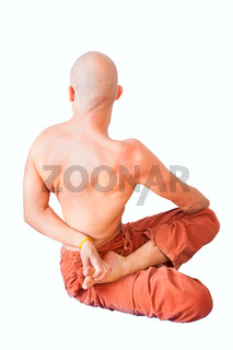 Twist in half lotus position by young man