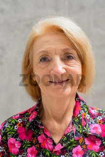 Portrait of a senior woman outdoors during summer smiling