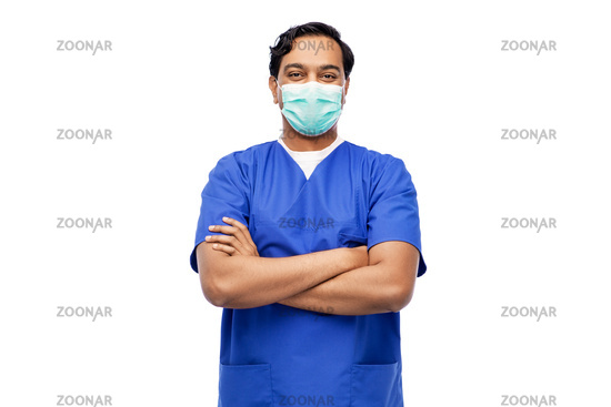 indian male doctor in blue uniform and mask