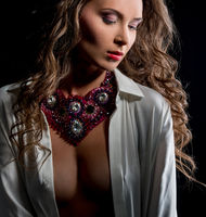 Glamour. Photo of sensual woman posing in jewels