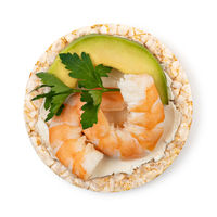 Rice cakes with cream cheese, shrimp, avocado and parsley