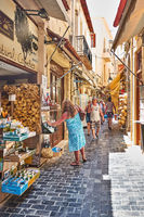 Shopping street with walking people in Rethymno