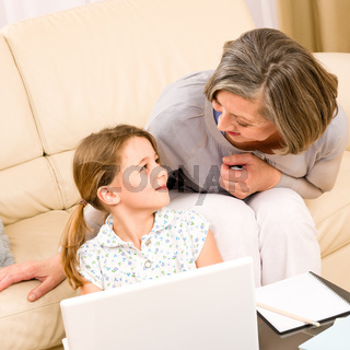 Grandmother with granddaughter use  computer