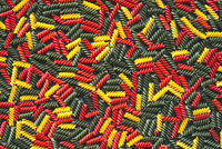Red green and yellow dry raw fusilli pasta. Colorful pasta background.