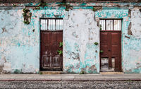 Vintage abandoned colonial building with plants growing out of the cracked walls, Antigua, Guatemala