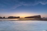 Yardang landform on water in sunset