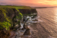 White, limestone cliffs seen from Magheracross viewpoint at dramatic sunset
