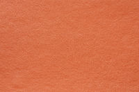 Synthetic orange leather for background. Close-up texture decoration material