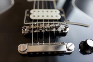 close up of bass guitar strings